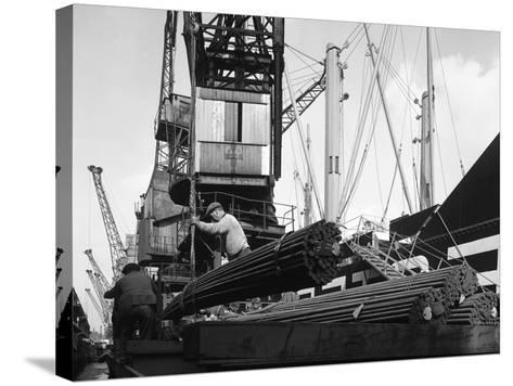 Dockers Loading Steel Bars onto the Manchester Renown, Manchester, 1964-Michael Walters-Stretched Canvas Print