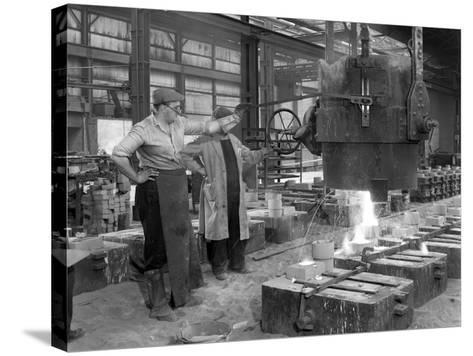 Pouring a Small Casting at Edgar Allens Steel Foundry, Sheffield, South Yorkshire, 1963-Michael Walters-Stretched Canvas Print