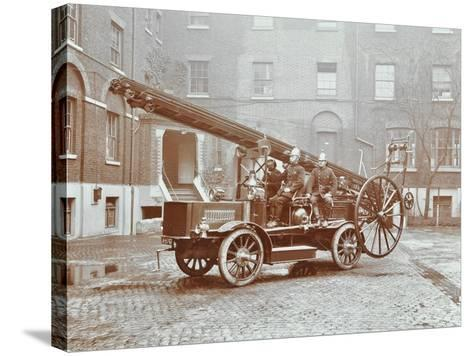 Firemen Aboard a Motor Fire Escape Vehicle, London Fire Brigade Headquarters, London, 1909--Stretched Canvas Print