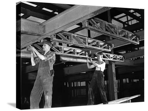 Engineers Lifting Steelwork into Position, South Yorkshire, 1954-Michael Walters-Stretched Canvas Print