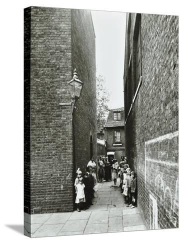 Children in an Alleyway, Upper Ground Place, Southwark, London, 1923--Stretched Canvas Print