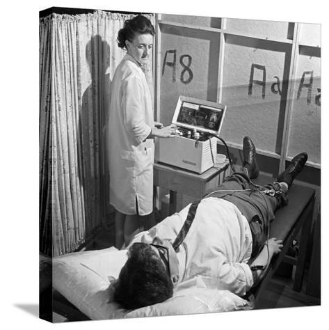 Nurse Using a Cardiopan Machine, Rotherham, South Yorkshire, 1967-Michael Walters-Stretched Canvas Print