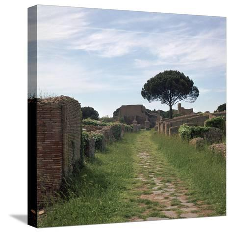Street and Buildings in the Roman Town of Ostia, 2nd Century-CM Dixon-Stretched Canvas Print