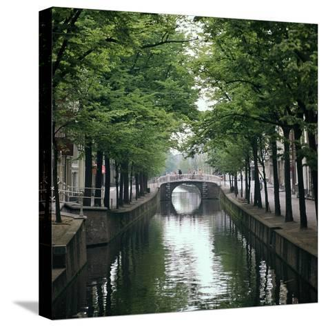Canal in Oude, Delft-CM Dixon-Stretched Canvas Print