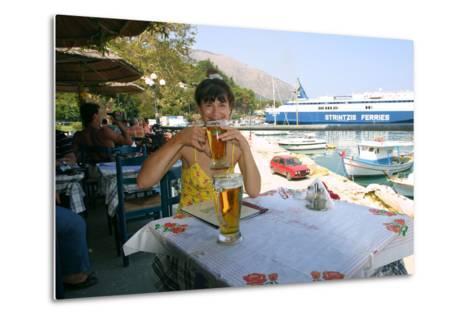 Woman Enjoying a Drink in a Harbourside Taverna, Poros, Kefalonia, Greece-Peter Thompson-Metal Print