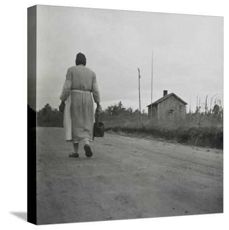 African American Midwife Carrying Her Medical Bag on a Dirt Road in Georgia--Stretched Canvas Print