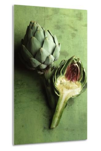 A Whole and a Half Artichoke on Green Background-Studio DHS-Metal Print