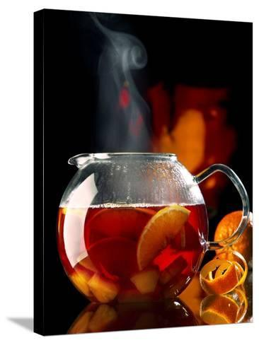 Steaming Red Wine Punch with Pieces of Fruit in Glass Teapot-J?rgen Klemme-Stretched Canvas Print
