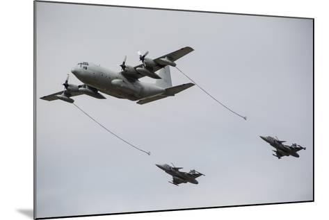 A Swedish Air Force C-130E Hercules with Two Czech Air Force Gripens in Tow-Stocktrek Images-Mounted Photographic Print