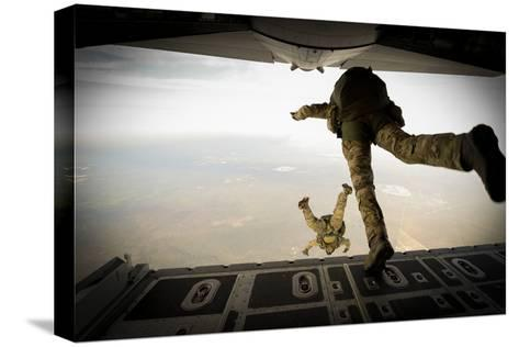 U.S. Army Green Berets Jump Out of a C-130H3 Hercules over Florida-Stocktrek Images-Stretched Canvas Print