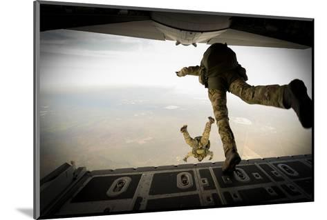 U.S. Army Green Berets Jump Out of a C-130H3 Hercules over Florida-Stocktrek Images-Mounted Photographic Print