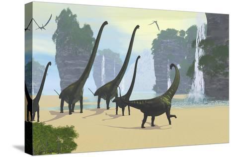 A Mamenchisaurus Dinosaur Herd Grazing Along a Lake-Stocktrek Images-Stretched Canvas Print