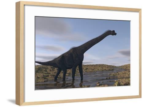 Large Brachiosaurus Walking Along a Dry Riverbed-Stocktrek Images-Framed Art Print