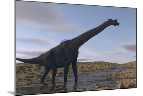 Large Brachiosaurus Walking Along a Dry Riverbed-Stocktrek Images-Mounted Art Print