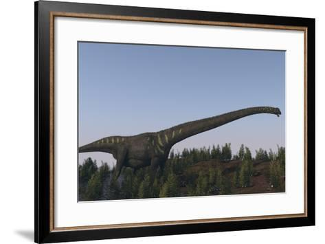 A Large Mamenchisaurus Walking Along a Dry Riverbed-Stocktrek Images-Framed Art Print