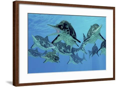 A Group of Ichthyosaurs Swimming in Prehistoric Waters-Stocktrek Images-Framed Art Print