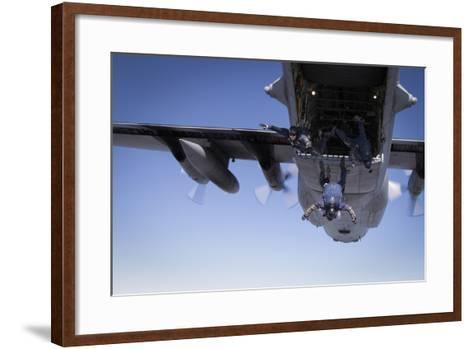 U.S. Navy Parachute Team, the Leap Frogs, Jump from a C-130 Hercules-Stocktrek Images-Framed Art Print
