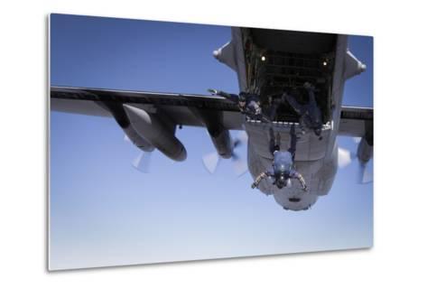 U.S. Navy Parachute Team, the Leap Frogs, Jump from a C-130 Hercules-Stocktrek Images-Metal Print