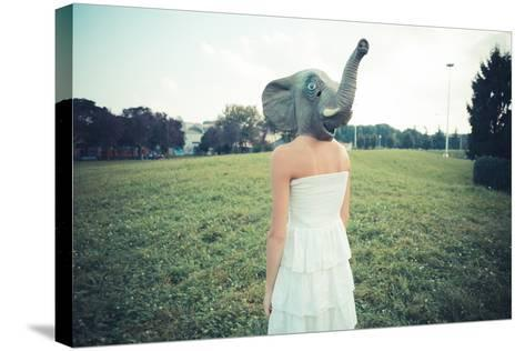 Elephant Mask Beautiful Young Woman with White Dress-Eugenio Marongiu-Stretched Canvas Print