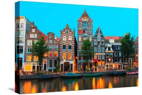 Night City View of Amsterdam Canals and Typical Houses, Holland, Netherlands.-kavalenkava volha-Stretched Canvas Print
