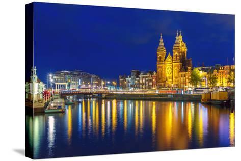 Night Amsterdam Canal and Basilica Saint Nichola-kavalenkava volha-Stretched Canvas Print