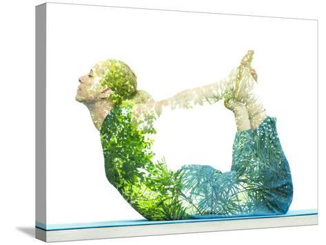 Combining Nature with Spiritual Yoga in a Creative Portrait of a Young Woman Lying with Her Body Ar-Victor Tongdee-Stretched Canvas Print