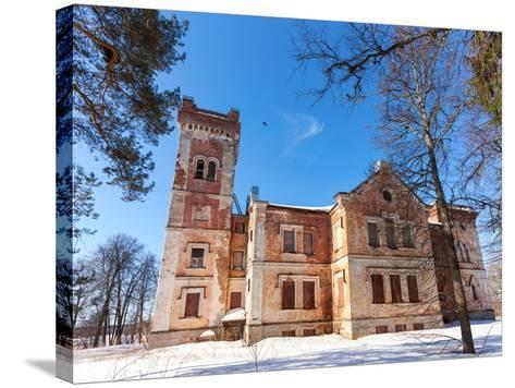 Old Brick Building on A Winter Day in Borovichi, Russia-blinow61-Stretched Canvas Print