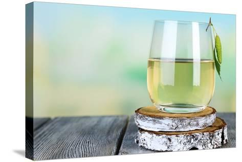 Glass of Fresh Birch Sap on a Wooden Table on Nature Background-Africa Studio-Stretched Canvas Print