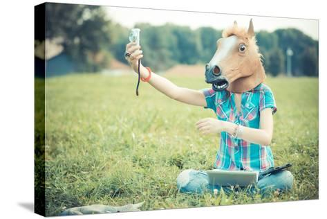 Horse Mask Unreal Hipster Woman Using Technology-Eugenio Marongiu-Stretched Canvas Print