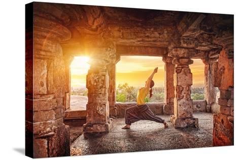 Yoga in Hampi Temple-Marina Pissarova-Stretched Canvas Print