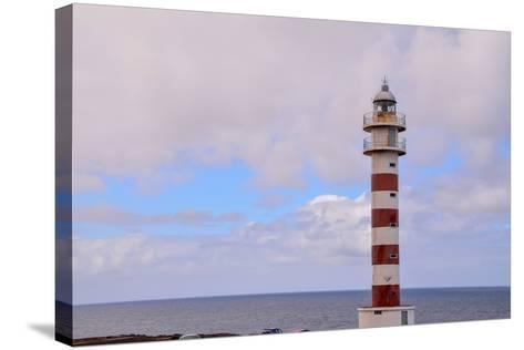 High Lighthouse near the Coast-underworld-Stretched Canvas Print