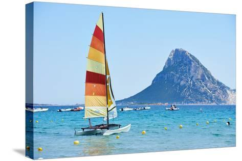 Scenic Italy Sardinia Beach Resort Landscape with Sail Boat and Mountains-kadmy-Stretched Canvas Print