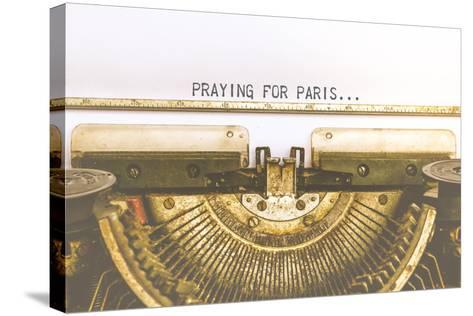 Typewriter and Empty White Paper with A Word Praying for Paris, Vintage Style-PongMoji-Stretched Canvas Print