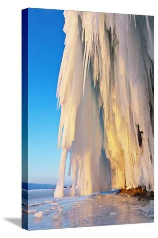 Lake Baikal. Ice and Icicles on Rocks in Sunset Light-katvic-Stretched Canvas Print
