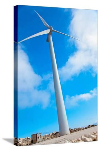 Modern Wind Turbine against Sky-EvanTravels-Stretched Canvas Print