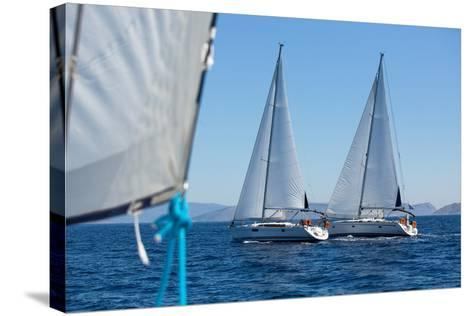 Sailing Ship Yachts with White Sails in a Row.-De Visu-Stretched Canvas Print