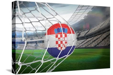 Football in Croatia Colours at Back of Net against Large Football Stadium with Lights-Wavebreak Media Ltd-Stretched Canvas Print