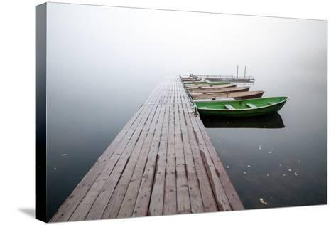 Autumn. Small Pier with Boats on Lake in Cold Still Foggy Morning-Eugene Sergeev-Stretched Canvas Print