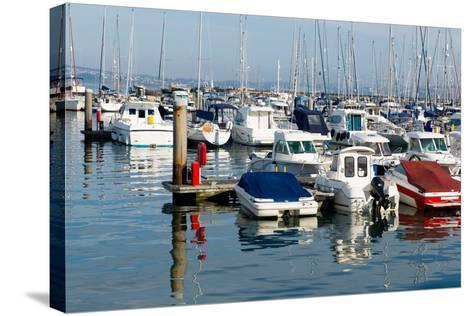 Motor Boats in a Marina with Masts and Calm Blue Sea-acceleratorhams-Stretched Canvas Print