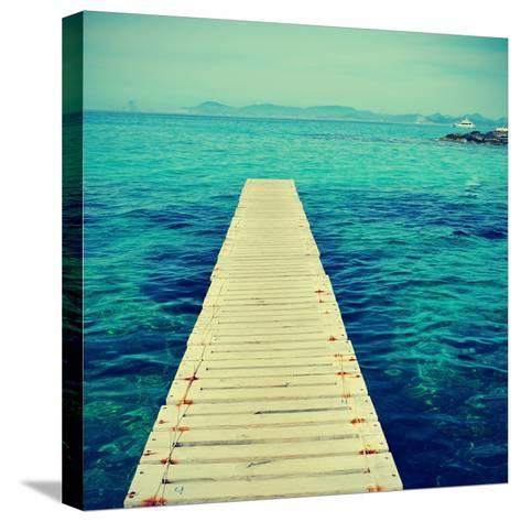 Boardwalk in Ses Illetes Beach in Formentera, Balearic Islands-nito-Stretched Canvas Print
