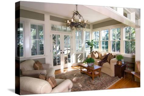 Furnished Sunroom with Large Windows and Glass Doors-Wollwerth Imagery-Stretched Canvas Print