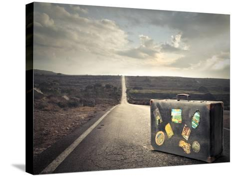 Vintage Suitcase on a Deserted Road-olly2-Stretched Canvas Print