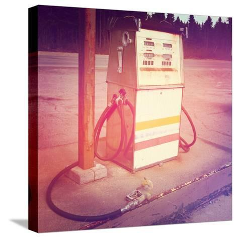 Old Gas Pump-melking-Stretched Canvas Print