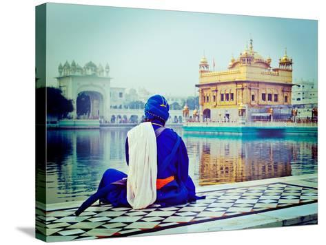 Vintage Retro Hipster Style Travel Image of Unidentifiable Seekh Nihang Warrior Meditating at Sikh-f9photos-Stretched Canvas Print