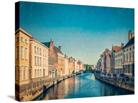 Vintage Retro Hipster Style Travel Image of Canal and Medieval Houses. Bruges (Brugge), Belgium Wit-f9photos-Stretched Canvas Print
