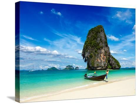 Long Tail Boat on Tropical Beach with Limestone Rock, Krabi, Thailand-f9photos-Stretched Canvas Print