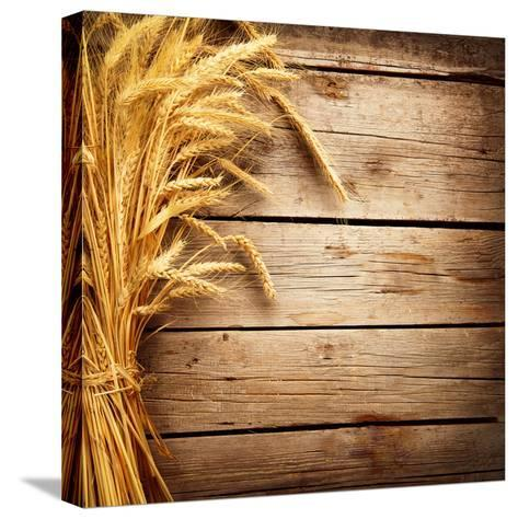 Wheat Ears on the Wooden Table, Sheaf of Wheat over Wood Background-Subbotina Anna-Stretched Canvas Print