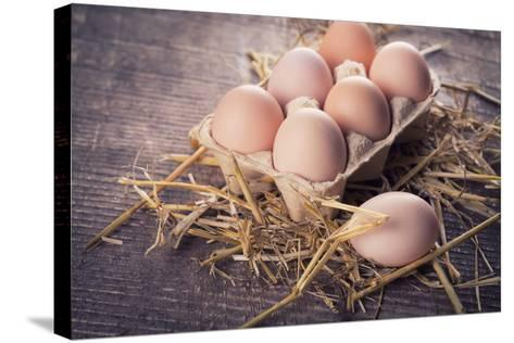 Chicken Eggs on Wooden Background-sobol100-Stretched Canvas Print