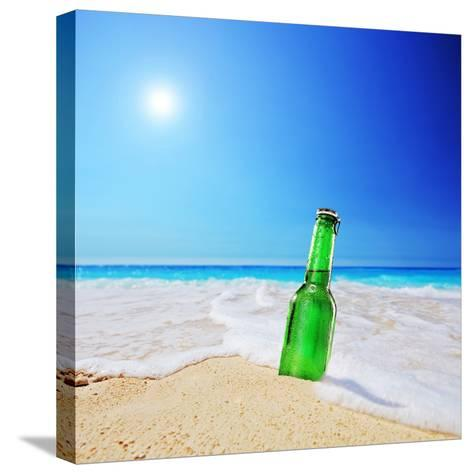 Beer Bottle on a Sandy Beach with Clear Sky and Wave, Shot with a Tilt and Shift Lens-buso23-Stretched Canvas Print