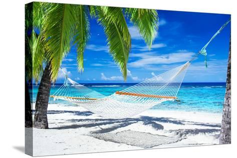 Empty Hammock between Palm Trees on Tropical Beach-Martin Valigursky-Stretched Canvas Print